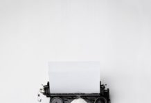 black Fayorit typewriter with printer paper