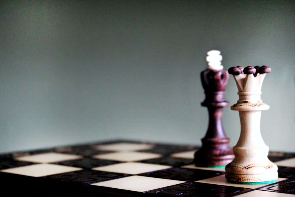 queen and king chess pieces on board